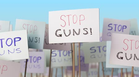 picketing : STOP GUNS placards at street demonstration. Conceptual loopable animation