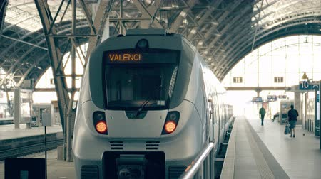 kalkış : Modern train to Valencia. Travelling to Spain conceptual intro clip Stok Video