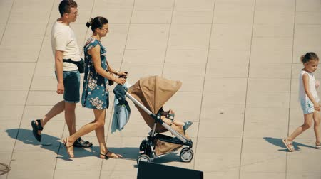 varšava : WARSAW, POLAND - MAY 31, 2018. Family walking with a stroller on a sunny day