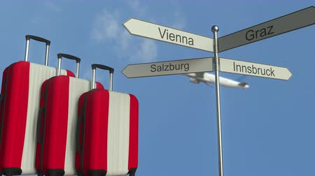 poste de sinalização : Travel baggage featuring flag of Austria, airplane and city sign post. Austrian tourism conceptual animation