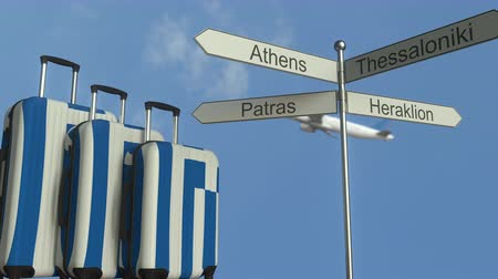 poste de sinalização : Travel baggage featuring flag of Greece, airplane and city sign post. Greek tourism conceptual animation