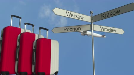 wrocław : Travel baggage featuring flag of Poland, airplane and city sign post. Polish tourism conceptual animation Wideo