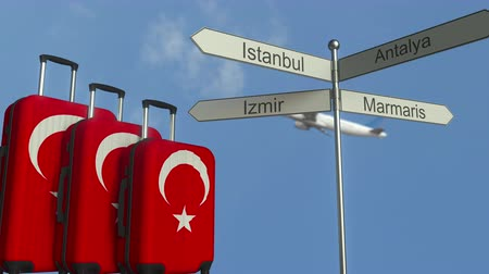 poste de sinalização : Travel baggage featuring flag of Turkey, airplane and city sign post. Turkish tourism conceptual animation