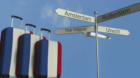 poste de sinalização : Travel baggage featuring flag of the Netherlands, airplane and city sign post. Dutch tourism conceptual animation
