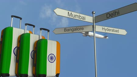 bangalore : Travel baggage featuring flag of India, airplane and city sign post. Indian tourism conceptual animation