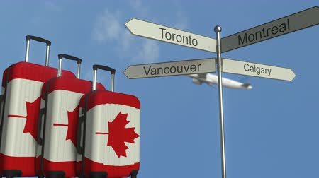 poste de sinalização : Travel baggage featuring flag of Canada, airplane and city sign post. Canadian tourism conceptual animation
