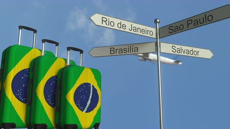 poste de sinalização : Travel baggage featuring flag of Brazil, airplane and city sign post. Brazilian tourism conceptual animation