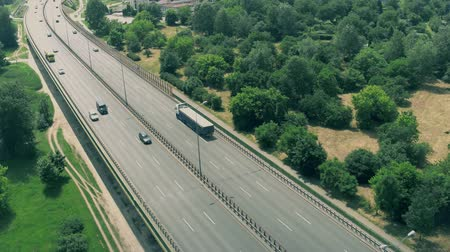 varsó : WARSAW, POLAND - JUNE 5, 2018. Aerial flyby view of highway traffic Stock mozgókép
