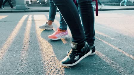 spor ayakkabısı : RUSSIA, MOSCOW - MAY 6, 2018. Slow motion shot of young people wearing sneakers and jeans