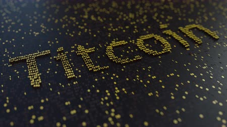 operacional : Titcoin word made of moving golden numbers. Cryptocurrency mining or transactions related conceptual animation Vídeos