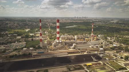 coal fired : Aerial view of coal power plant and distant city Stock Footage