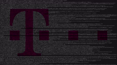 gsm : T-Mobile logo made of source code on computer screen. Editorial loopable animation Stock Footage