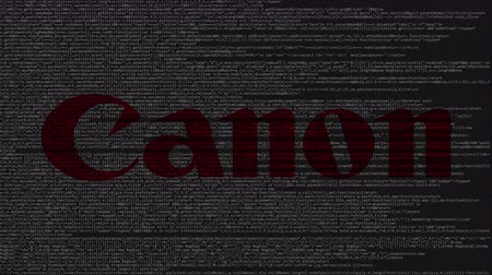 canon : Canon Inc. logo made of source code on computer screen. Editorial loopable animation Stock Footage
