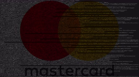 inc : MasterCard logo made of source code on computer screen. Editorial loopable animation Stock Footage