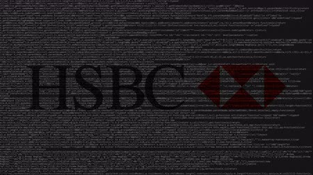 logotype : HSBC logo made of source code on computer screen. Editorial loopable animation