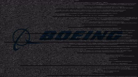 inc : Boeing logo made of source code on computer screen. Editorial loopable animation Stock Footage
