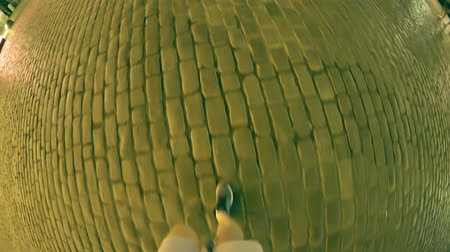 pace : Man walks on the pavemente in the evening. Fish-eye shot Stock Footage