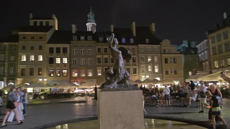 mermaid : WARSAW, POLAND - AUGUST 4, 2018. City symbol monument of Syrenka Warszawska or Mermaid of Warsaw in old town in the evening