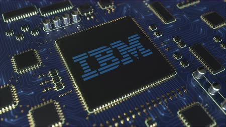 componente : Computer printed circuit board or PCB with IBM logo. Conceptual editorial 3D animation