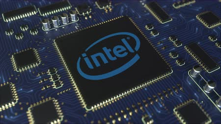 intel : Computer printed circuit board or PCB with Intel Corporation logo. Conceptual editorial 3D animation