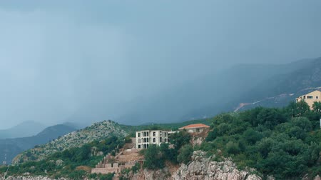 wetness : Dark rain storm clouds over Adriatic sea coast in Montenegro