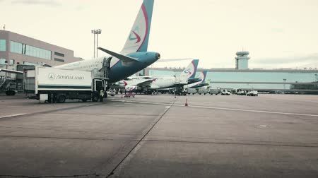 ural : MOSCOW, RUSSIA - AUGUST 5, 2018. Commercial airplanes boarding at Domodedovo airport terminal