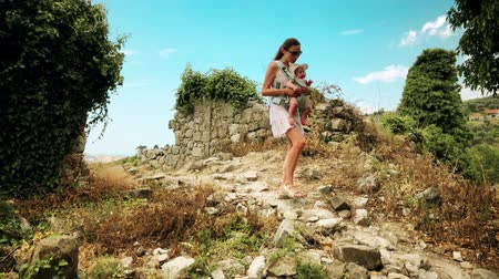 podróżnik : Young woman and her baby traveling with carrier backpack on vacation