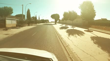 szieszta : POV driving shot of leaving small town in Spain on a hot summer day Stock mozgókép