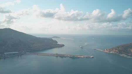 tow : Aerial view of big ship entering harbour of Cartagena, Spain Stock Footage