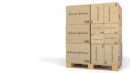 palety : Boxes with Johnson and Johnson logo on warehouse pallet. Editorial 3D animation