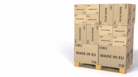 stacks : MADE IN EU text on warehouse cartons. 3D animation