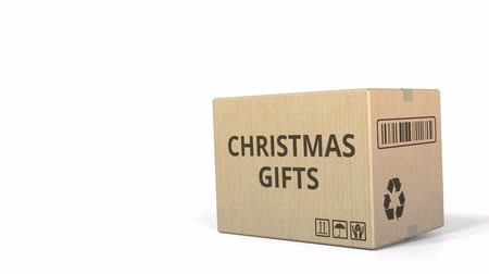 logisztikai : Falling box with CHRISTMAS GIFTS inscription. 3D animation Stock mozgókép
