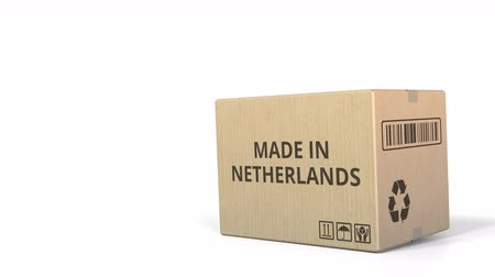 logisztikai : Carton with MADE IN NETHERLANDS text. 3D animation
