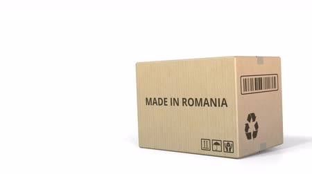 logisztikai : Box with MADE IN ROMANIA caption. 3D animation Stock mozgókép