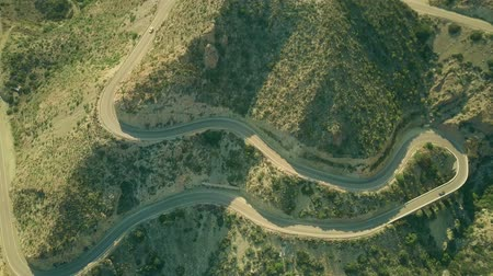 Андалусия : Aerial top down view of a windy hairpinned road in mountains. Andalusia, Spain