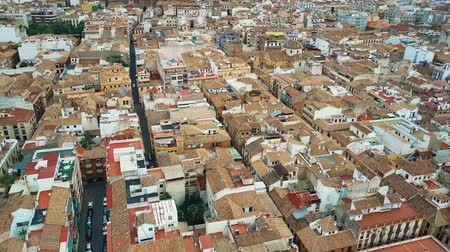 architectural heritage : Aerial view of old tiled sloping roofs and narrow streets in Granada centre, Spain