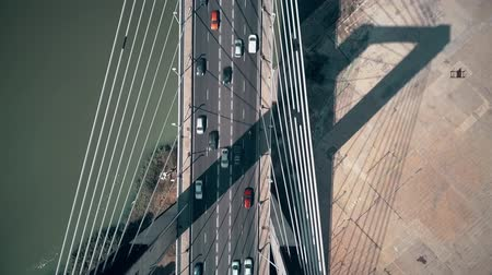 pilon : Aerial top-down view of cars moving along cable-stayed bridge
