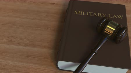 caso : MILITARY LAW book and court gavel. 3D animation