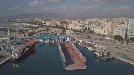 damarlar : MALAGA, SPAIN - SEPTEMBER 27, 2018. Aerial view of the Mario Lopez Shipyard Stok Video