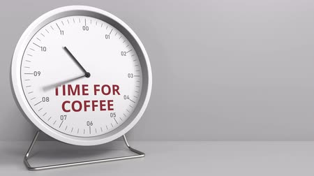 druhý : Clock face with revealing TIME FOR COFFEE text. Conceptual animation