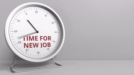 напоминать : TIME FOR NEW JOB caption on the clock face. Conceptual animation