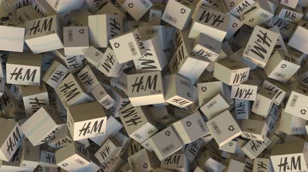 reciclado : H&M logo on piled cartons. Editorial animation