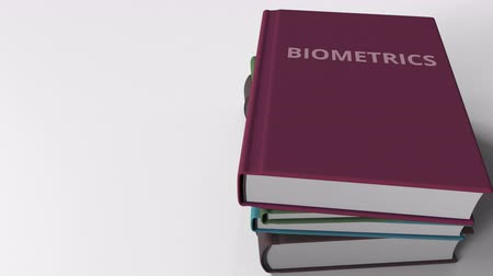 examining : Book cover with BIOMETRICS title. 3D animation Stock Footage