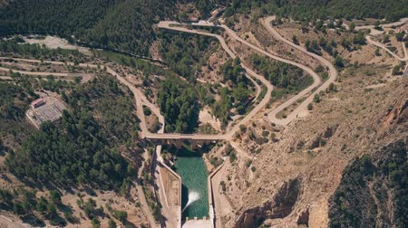 etrafında : Aerial down view of windy hairpinned car road and dam in mountains in Spain