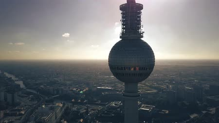 berlin skyline : Aerial view of Berlin cityscape behind the silhouette of the television tower Stock Footage