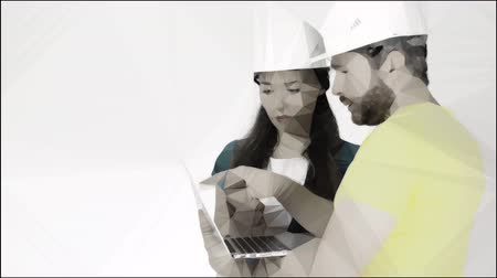 stilize : Man and woman wearing construction hard hats use laptop. Conceptual lowpoly clip