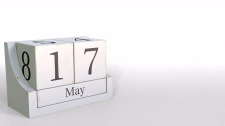 seventeen : Wood cube calendar shows May 17 date, 3D animation