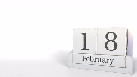 osiemnastka : Cube calendar shows February 18 date. 3D animation