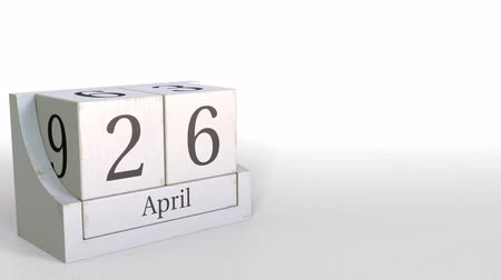 nisan : April 26 date on wooden blocks calendar. 3D animation Stok Video