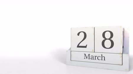 eight : Wood cube calendar shows March 28 date, 3D animation